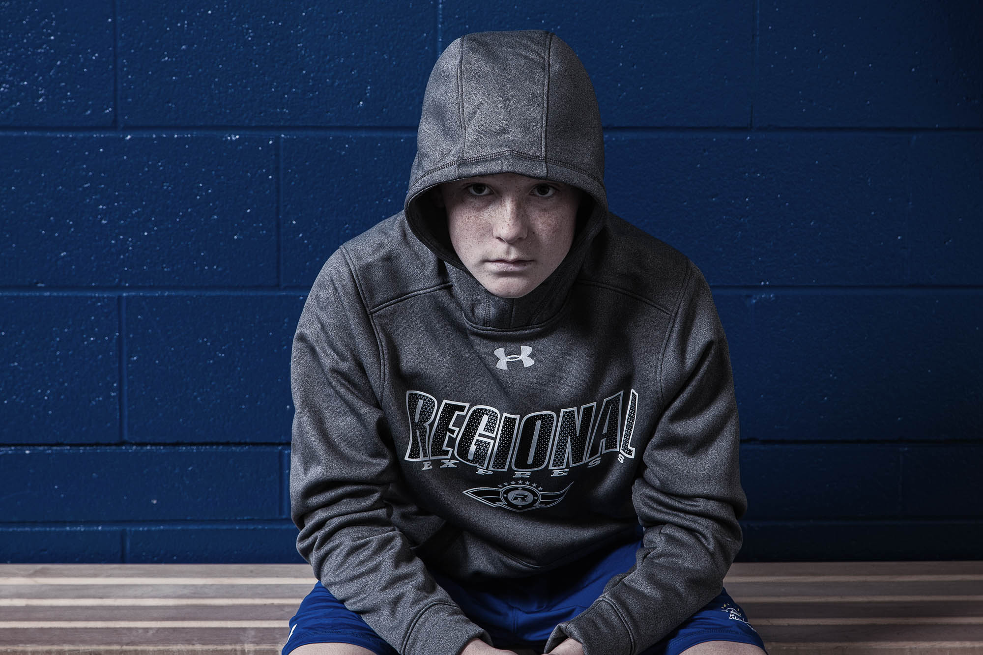 Promising young hockey player wears Under Armour in sportswear shoot