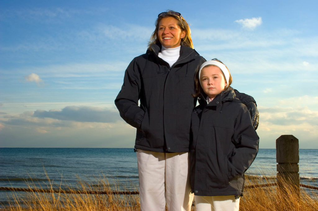 Location Black Coats- Woman and Girl Models on Beach in Late Fall