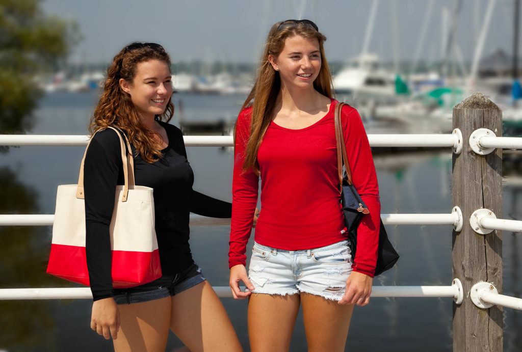 Girls' Summer Fashion  - Two Female Models on Boardwalk by Water