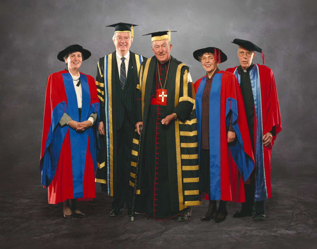 The Late Cardinal Carter (center), Dr. Richard Alway - with Honourands in red gowns - on the occasion of Convocation