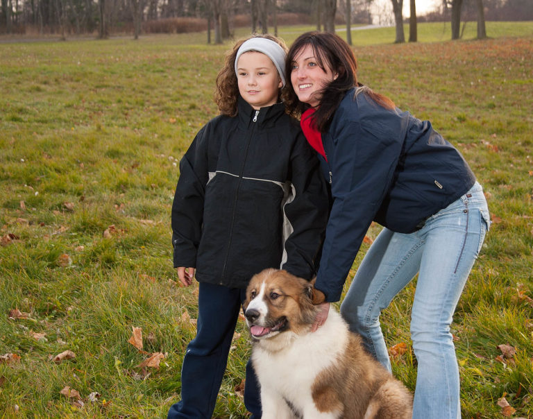 female model with dog wearing fall jackets