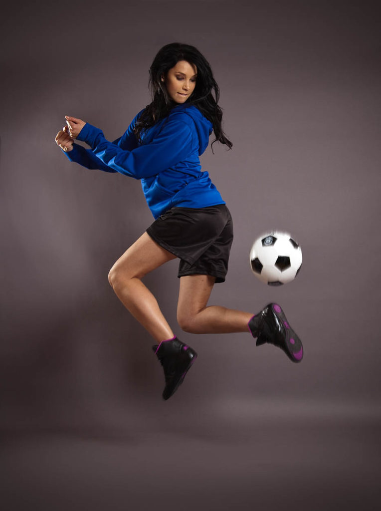 Warm-ups - Female Model Jumping with Soccer Ball