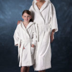 adult and child models wearing white spa apparel