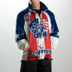 male model wearing jacket with USA artwork