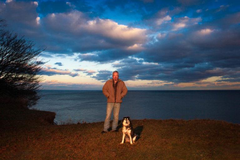 man and dog at sunset