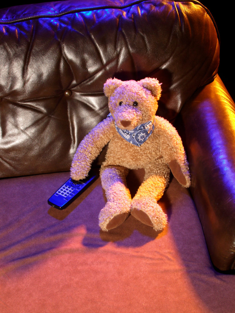 teddy bear watching tv